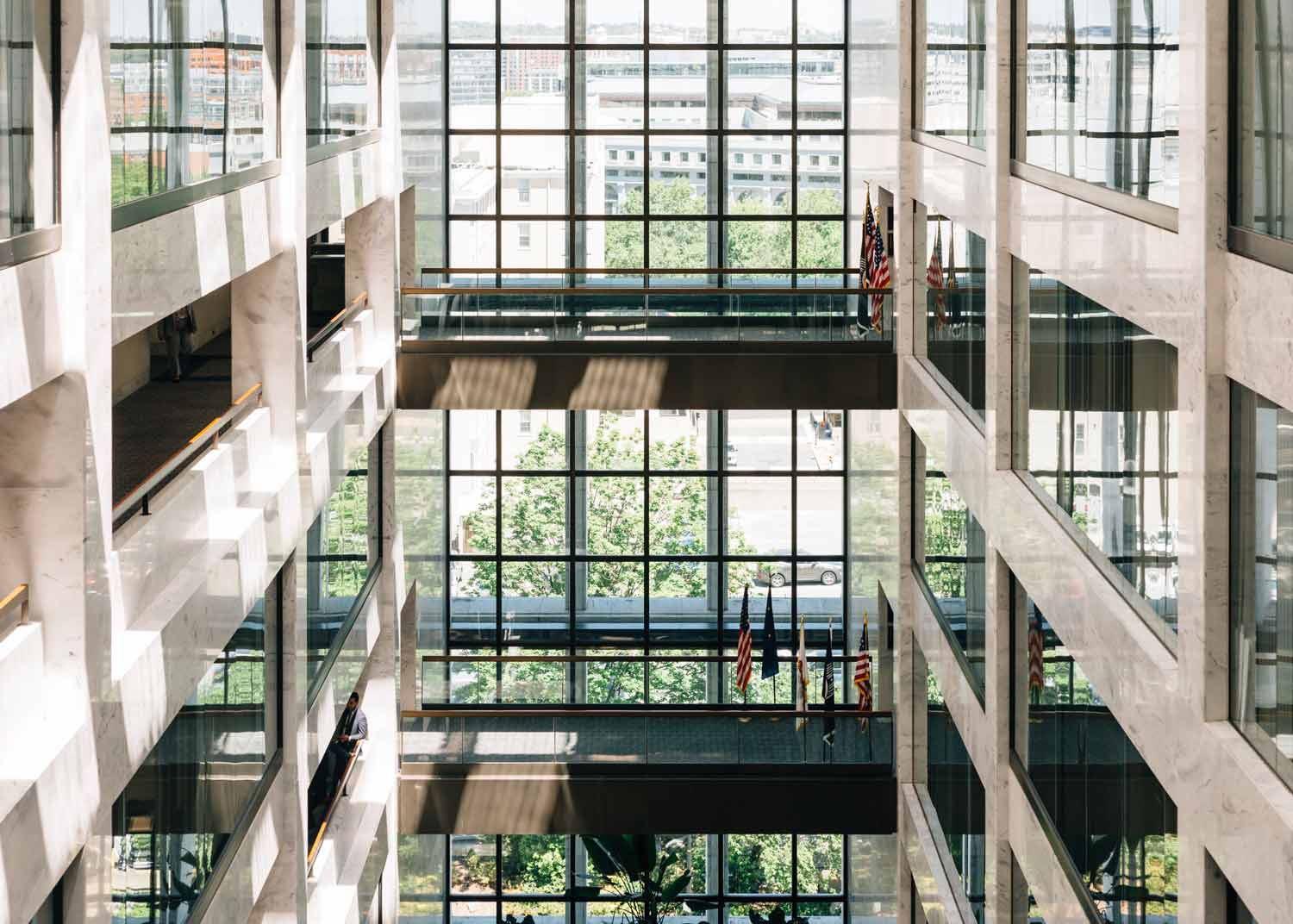 inside a large scale business building with large floor to ceiling windows